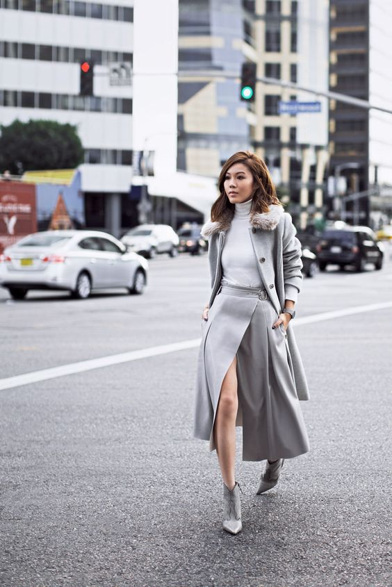 a total dove grey look with a white turtleneck, a midi A line wrap skirt, booties and a short coat with faux fur