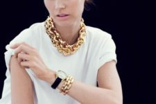 a touch of luxury with a chunky gold chain necklace and matching bracelets will raise your look to a new level