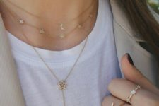a trio of celestial-themed necklaces – a moon and a rhinstone one plus a lariat rhinestone star necklace