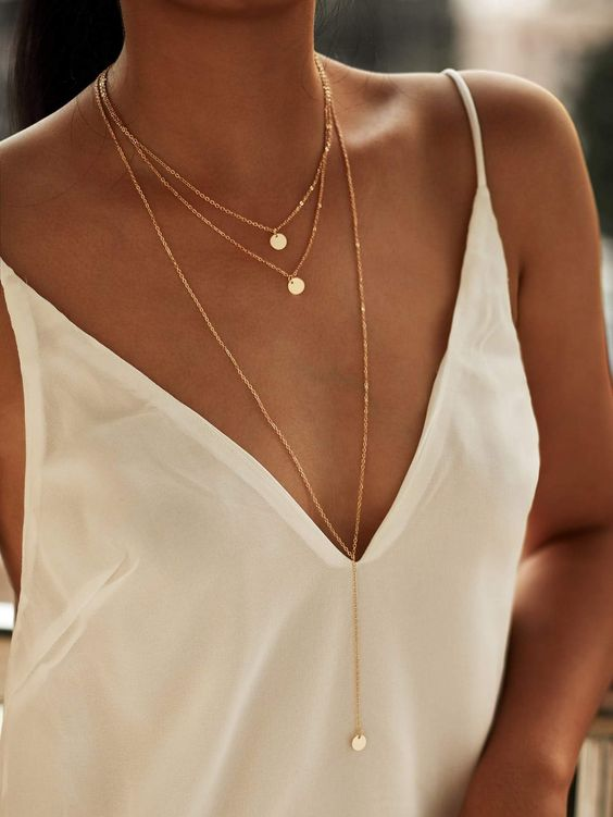 a trio of matching gold necklaces with small coin pendants including a plunging necklace for a truly boho look