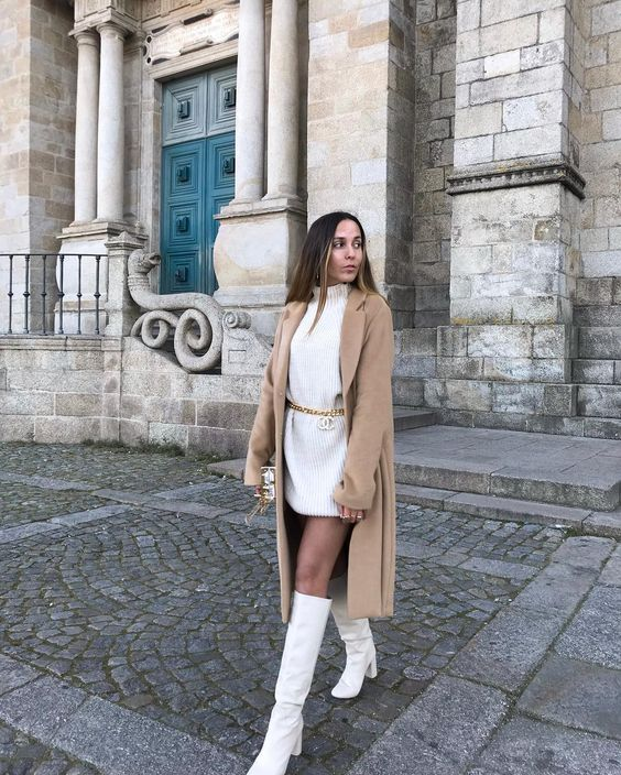a white sweater mini dress, white knee boots, a tan coat for a minimal winter outfit