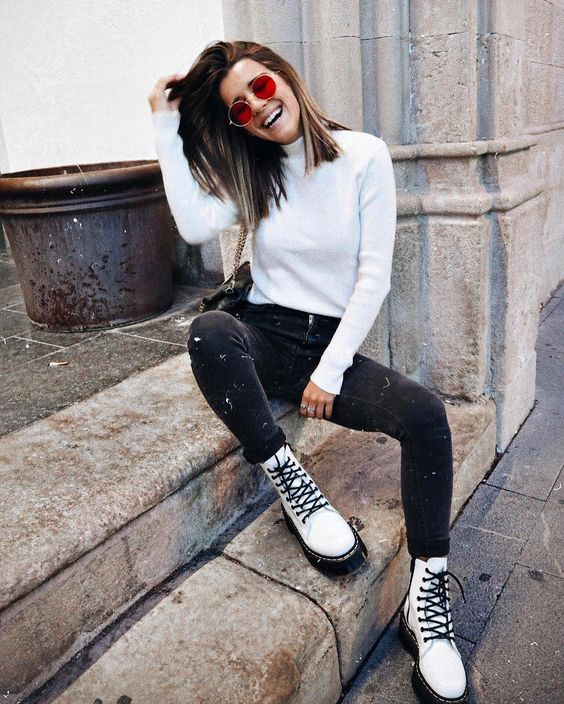 a white turtleneck, black skinnies and white combat boots for a casual look with a bit of grunge