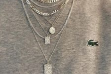 a whole stack of silver necklaces including matching chains, delicate chainrs with pendants