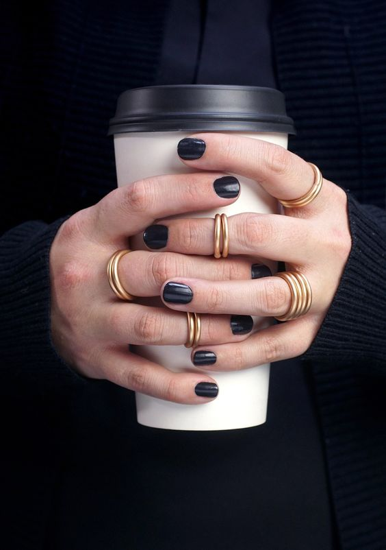 alll matching stacking bronze midi rings are a cool solution for a truly minimalist girl