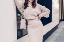 an oversized blush sweater, a blush midi pencil skirt with a front slit, a white bag for winter