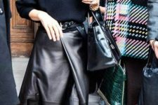 an oversized midnight bleu sweater, a black wrap leather midi skirt, black fur loafers and a black bag