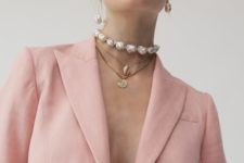baroque pearl earings and a necklace plus some seashell and coin necklaces for a bold and cool look