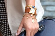 chic stacked bracelets – dainty gold chains with coins, a coin one with a bead and a watch with a brow strap
