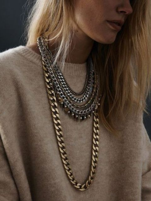 layered chunky and usual chain necklaces with fringe and pearls will make your look unique