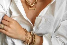 layered chunky necklaces – a chain and a bar one plus matching layered bracelets in gold for a bold look