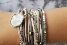 silver bead and leather cord bracelets mixed up with a statement pendant one for a boho look