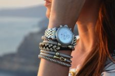 stacked bracelet with beads and texture in the same style plus a watch with a silver finish for a bold look