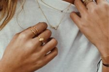 stacked gold moonstone rings and rigns with no rhinestones on the second hand for a cooler look