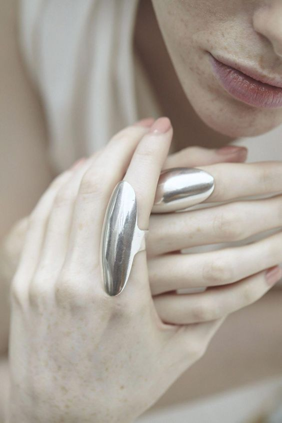 statement silver rings with polished surfaces is a gorgeous idea to accent your look and make it trendy
