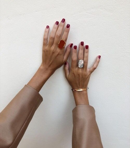 statement statement rings - a moonstone one and a red opal one for a modern outfit
