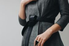 two statement geometric rings – a circle and a triangle in black and in framing
