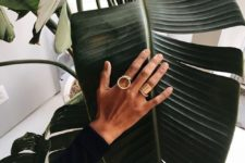two statement rings – a cricle one and a wide thick polished gold one for a modern and bold look