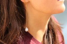 ultra-modern gold bar and baroque pearl earrings look minimalist and girlish at the same time