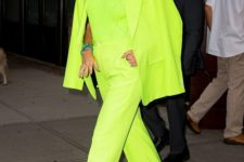 02 Blake Lively wearing a full neon green look with a pantsuit, a crochet top and pink embellished shoes