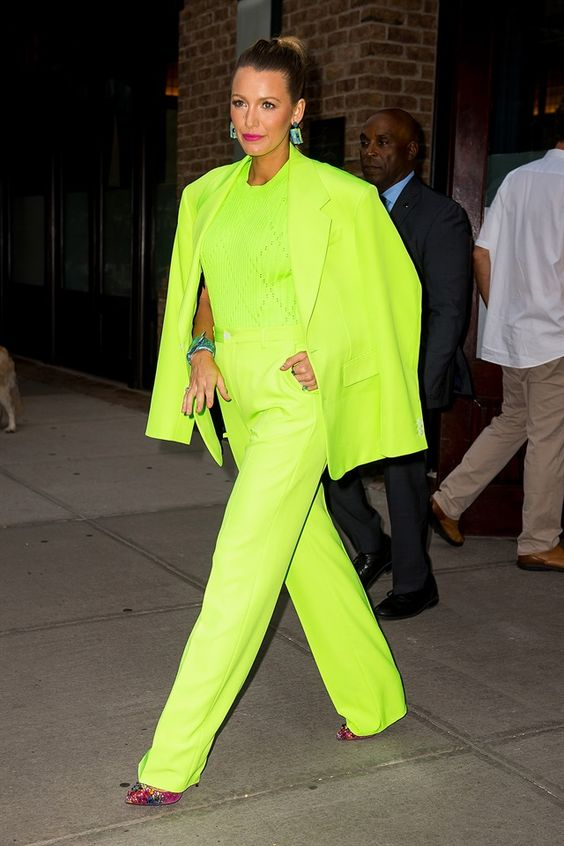 Blake Lively wearing a full neon green look with a pantsuit, a crochet top and pink embellished shoes