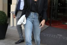 02 a black lace top, a black blazer, black shoes and light blue straight jeans with a raw hem