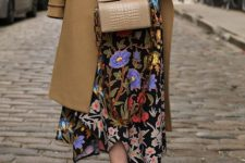 02 a bright yet moody floral midi dress with a pink belt, blue shoes, a camel bag and a camel coat