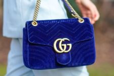 02 a chic and elegant classic blue velvet bag with gold detailing is a refined idea for a fashion-forward person