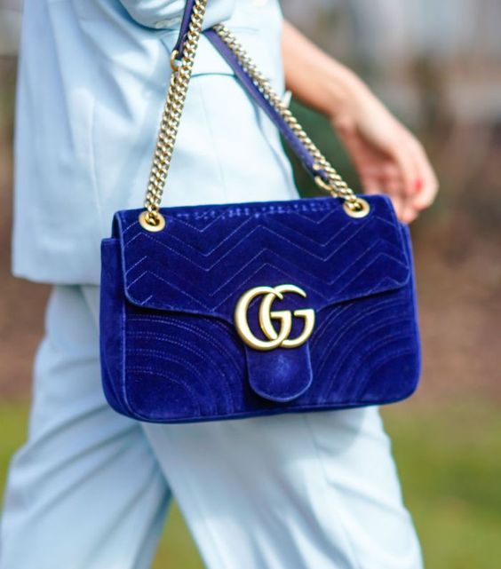 a chic and elegant classic blue velvet bag with gold detailing is a refined idea for a fashion-forward person
