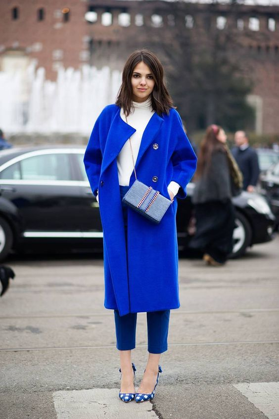 a classic blue coat and blue pants and shoes to support the color scheme of the look