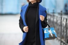 02 a monochromatic winter outfit of a black turtleneck, pants, a coat, a blue waistcoat, hat and a bag