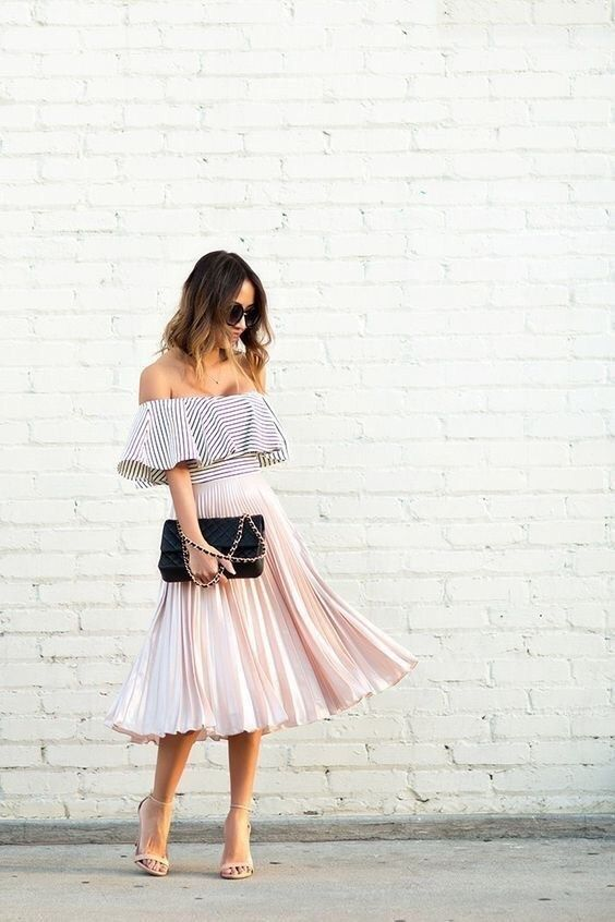 a striped off the shoulder top, a pink pleated midi skirt, nude shoes and a black clutch