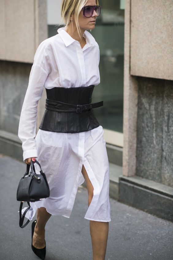 a white midi shirtdress, a black corset belt, black shoes and a small bag for a bold monochromatic look