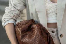 02 a woven brown leather soft clutch is a fashion statement – inspite of its classic color, it features a woven structure