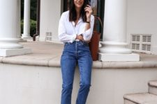 03 90s inspired cheeky blue jeans, black slingbacks, a white shirt and a brown leather bag
