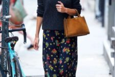 03 a black sweater, a dark floral print skirt, black sneakers and an amber bag for a hipster look