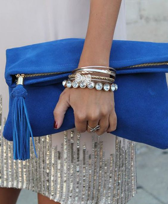 a chic and simple classic blue clutch with a tassel is a stylish colorful accessory for any outfit