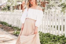 03 a romantic spring look with a white off the shoulder blouse, a tan pleated midi, nude shoes