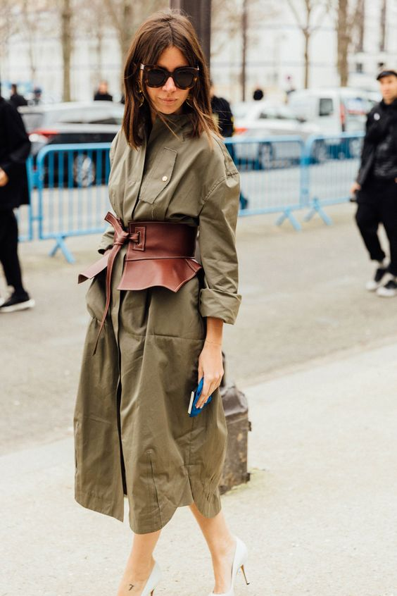 an olive green midi shirtdress with long sleeves, a brown corset belt for a girlish accent