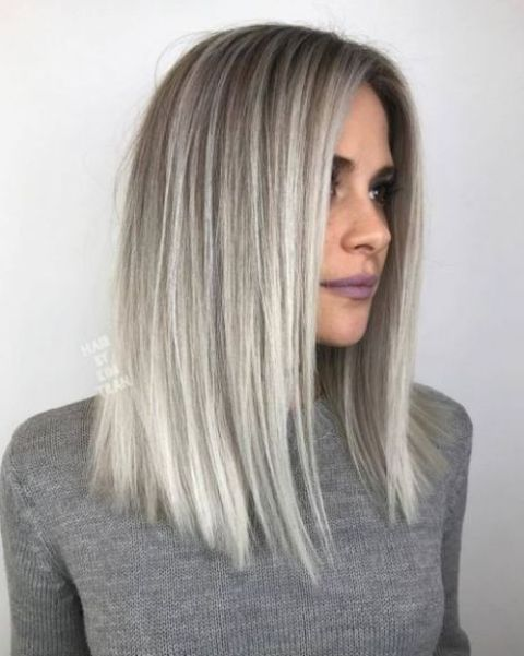 silver blonde balayage on darker hair and medium length is a hot idea to rock this year