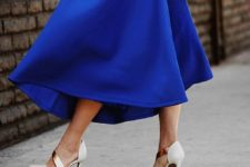 04 a classic blue A-line midi skirt and a matching classic blue bag for creating ultimate looks for this year