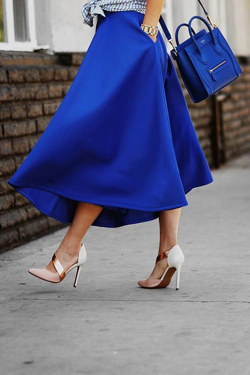 a classic blue A-line midi skirt and a matching classic blue bag for creating ultimate looks for this year