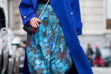 04 a classic blue midi coat, a turquoise printed skirt and matching trainers for a bold winter look