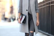 04 a monochromatic grey outfit with a turtleneck sweater, grey ripped skinnies, shoes and a grey sleeveless coat