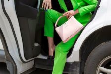 04 a neon green pantsuit, a black turtleneck, black mules and a pink bag for a spring work look