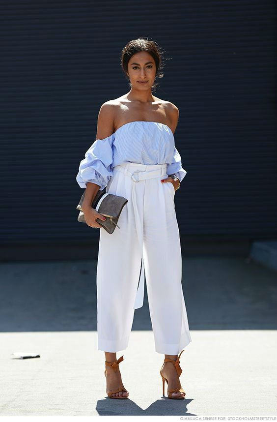 a stylish look with a blue off the shoulder top, high waisted wideleg pants, bow shoes and a clutch