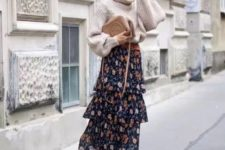 04 an oversized neutral sweater, a dark floral print ruffle skirt, brown boots and a beige bag