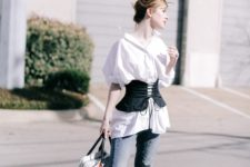 04 blue jeans, a white oversized shirt, a black corset belt, black shoes and a whimsy bag