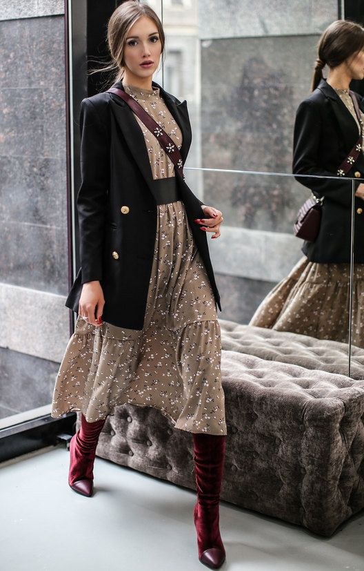 a beige floral midi dress with a high neckline, an oversized black blazer, burgundy boots and a bag
