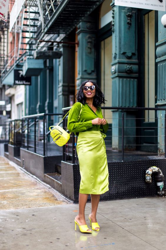 a bold neon look with a bright green shirt, a neon green skirt, neon yellow shoes and a backpack