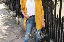05 a casual look with a white tee, blue ripped denim, an oversized marigold blazer and black shoes